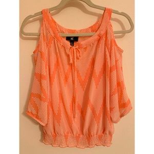 Coral cut off sleeve top